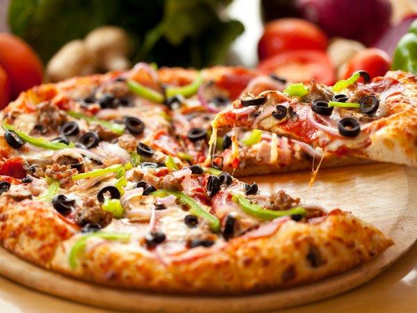 Пицца лучше денег: Ученые назвали стимул для повышения производительности